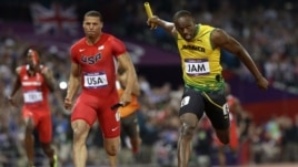 Jamaica's Usain Bolt crosses the finish line ahead of United States' Ryan Bailey to win the men's 4x100-meter relay final during the athletics in the Olympic Park during the 2012 Summer Olympics, Saturday, Aug. 11, 2012, in London.