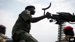 A government soldier mans a vehicle-mounted machine gun in the oil-rich town of Malakal, South Sudan.