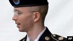 Army Pfc. Bradley Manning is escorted out of a courthouse in Fort Meade, Md. after receiving a verdict in his court martial, July 30, 2013.