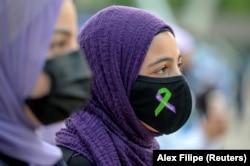 Masyarakat melakukan protes Islamofobia, di Toronto, Ontario, Kanada 18 Juni, 2021. (Foto: REUTERS/Alex Filipe)