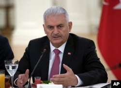 FILE - Turkish Prime Minister Binali Yildirim speaks during a meeting with representatives of German companies, in Ankara, Turkey, July 27, 2017.