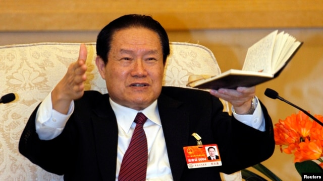 Zhou Yongkang gestures as he speaks at a group discussion of Shaanxi Province during the National People's Congress at the Great Hall of the People in Beijing, March 12, 2011.