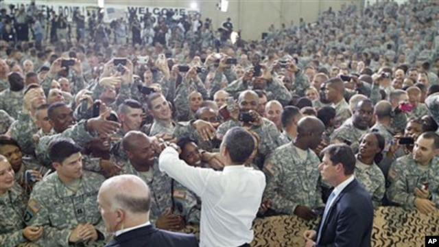 President Barack Obama greets military personnel who have recently returned from Afghanistan after speaking about the mission that resulted in the death of Osama bin Laden, at Fort Campbell, Kentucky, May 6, 2011