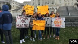 A group of high school students from the DMV area pose for a picture for reporters on the morning of March 14, 2018. They along with thousands of high school students around the country walked out of classes to protest gun violence in schools.