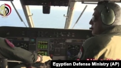 An Egyptian plane searches in the Mediterranean Sea for the missing EgyptAir flight 804 plane, which crashed after disappearing from the radar early Thursday while carrying 66 passengers and crew from Paris to Cairo, in video image released May 19, 2016.