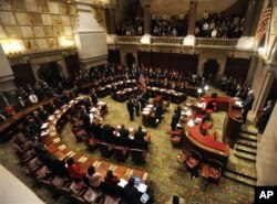 FILE - Members of New York's Electoral College meet in the New York state Senate Chamber to confirm the election of President Barack Obama and Vice President Joseph Biden, in Albany, New York, December 17, 2012.