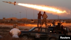 Fighters of Libyan forces allied with the U.N.-backed government fire a rocket at Islamic State fighters in Sirte, Libya, August 4, 2016.