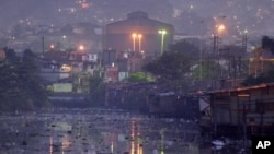 Waters of polluted Guanabara Bay pass through Manguinhos slum, Rio De Janeiro, undated file photo.
