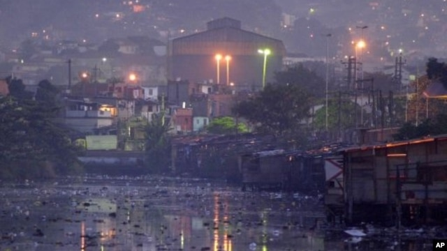 Waters of polluted Guanabara Bay pass through Manguinhos slum, Rio De Janeiro, undated file photo.