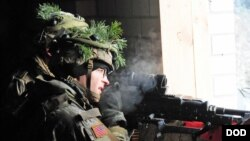 FILE - A U.S. paratrooper participates in a NATO exercise at an urban training center in Pabrade, Lithuania.