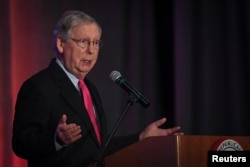 FILE - U.S. Senate Majority Leader Mitch McConnell speaks at the Republican Party of Kentucky's Lincoln Dinner in Louisville, Aug. 26, 2017.