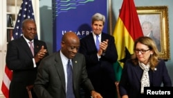 (L-R) Ghana President John Dramani Mahama, Ghana Finance Minister Seth Terkper, U.S. Secretary of State John Kerry and Dana Hyde, CEO of the Millennium Challenge Corporation (MCC), participate in the Ghana Compact Signing Ceremony at the State Department