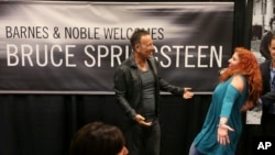"""Bruce Springsteen greets a fan at the launch of his autobiography, """"Born to Run,"""" at the Barnes & Noble in Freehold, N.J., the town where he grew up, Sept. 27, 2016."""