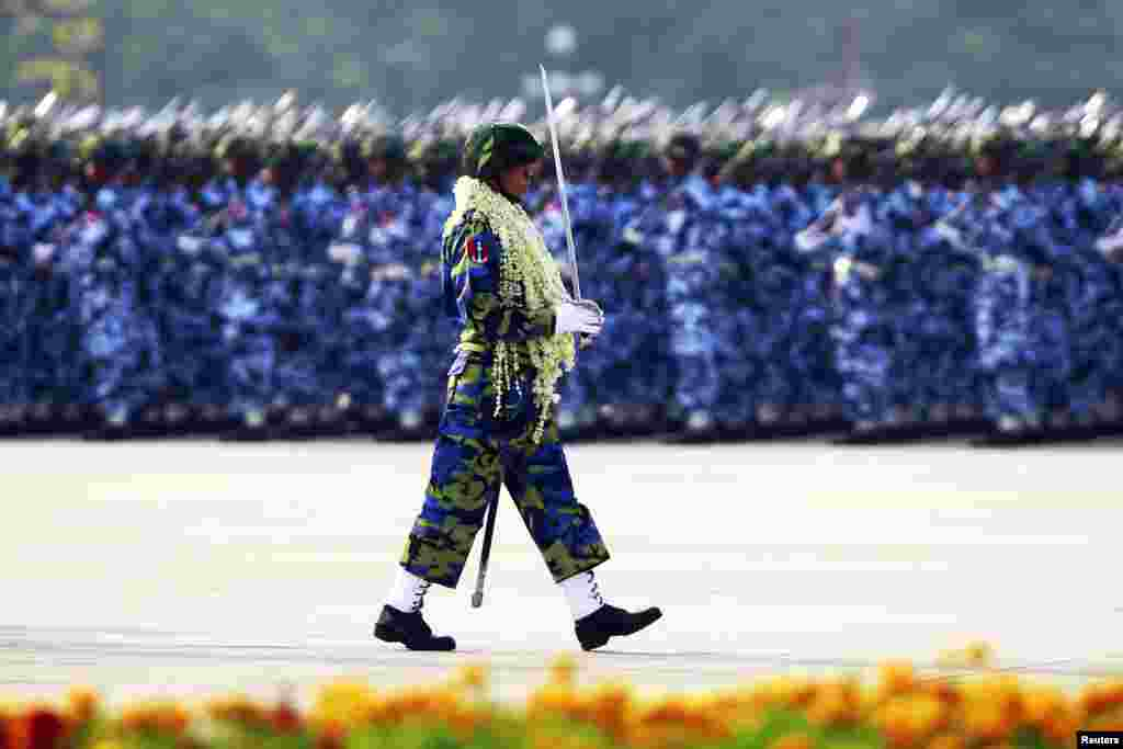 An honor guard marches during a parade to mark the 68th anniversary of Armed Forces Day in Burma's capital Naypyitaw, March 27, 2013.