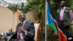 FILE - South Sudan's rebel leader Riek Machar, left, speaks to the media about the situation in South Sudan following last week's peace agreement with the government, in Addis Ababa, Ethiopia,Aug. 31, 2015.
