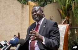 FILE - South Sudan's Riek Machar speaks to reporters following the signing of the peace agreement with the South Sudan government, in Addis Ababa, Ethiopia, Aug. 31, 2015.