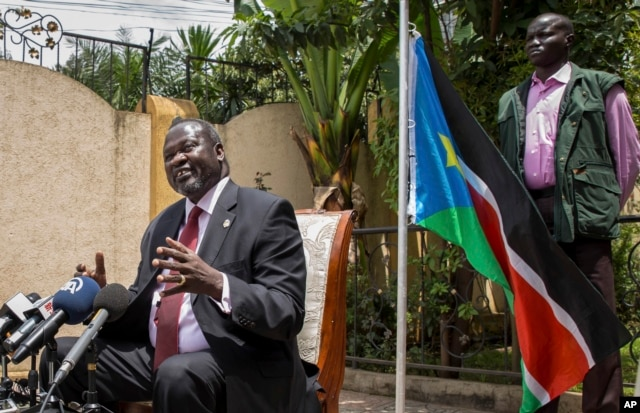 FILE - South Sudan's rebel leader Riek Machar, left, speaks to the media about the situation in South Sudan following last week's peace agreement with the government, in Addis Ababa, Ethiopia, Aug. 31, 2015.