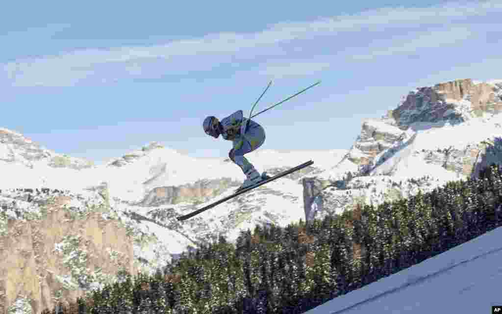 Norway's Kjetil Jansrud speeds down the course during an alpine ski men's World Cup downhill training, in Val Gardena, Italy.