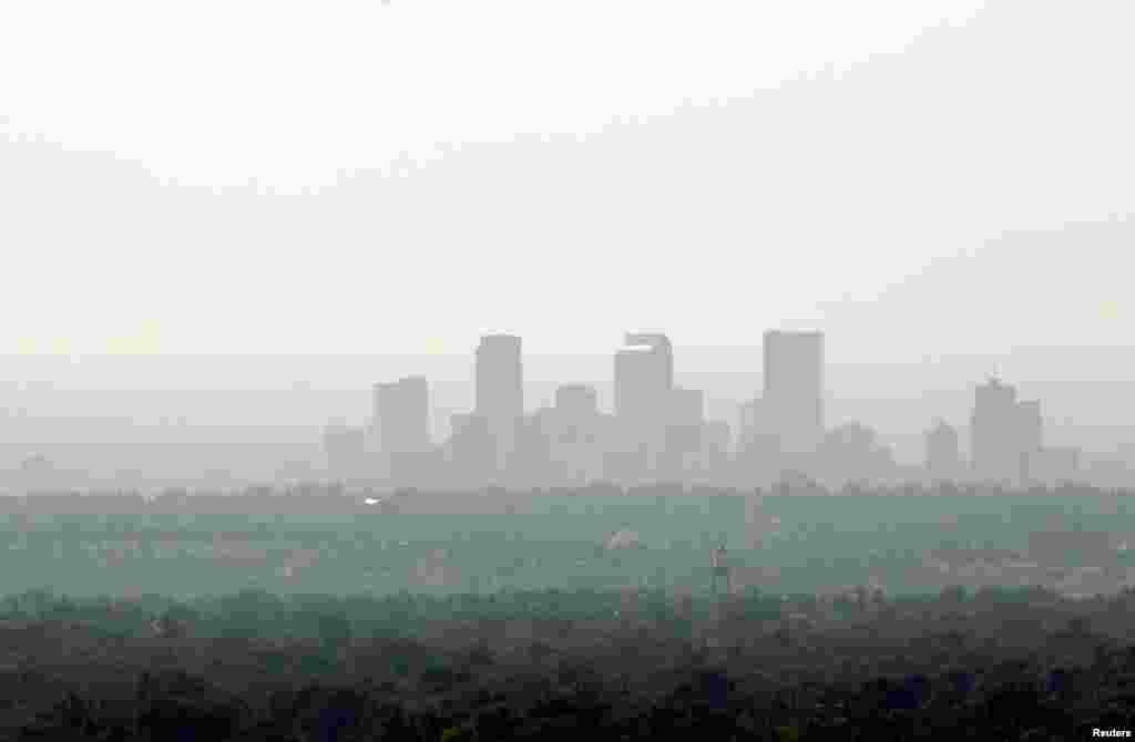 The downtown skyline of Denver, Colorado is obscured by smoke from the many wildfires burning in the state.