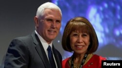 FILE - U.S. Vice President-elect Mike Pence poses with Elizabeth Kautz, mayor of Burnsville, at the U.S. Conference of Mayors' 85th Winter Meeting in Washington, Jan. 17, 2017.