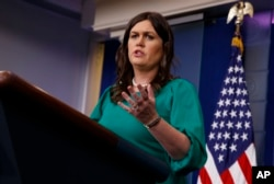 FILE - White House press secretary Sarah Sanders speaks during the press briefing at the White House, May 7, 2018. Sanders said the White House has compete confidence in Gina Haspel, President Donald Trump's nominee to head the Central Intelligence Agency.