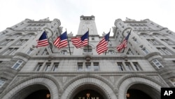 FILE - The Trump International Hotel at 1100 Pennsylvania Ave. NW, in Washington, Dec. 21, 2016. A hotel guest was arrested Wednesday with weapons and ammunition.