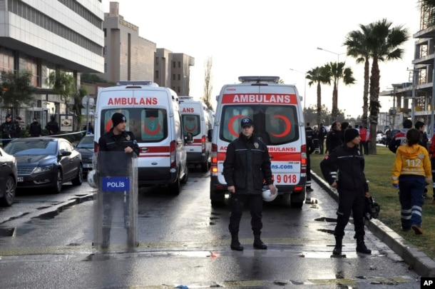 Security members and ambulances attend the explosion site in the Aegean city of Izmir, Turkey, Jan. 5, 2017.