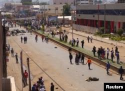 FILE - Anti-government demonstrators block a road in Bamenda, Cameroon, December 8, 2016.