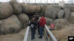 This Feb. 27, 2011 picture shows visitors touring the coastal fog desert area of the Biosphere 2 complex in Oracle, Ariz. (AP Photo/Allen Breed)