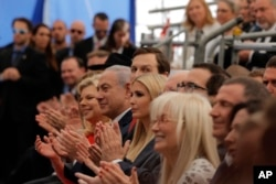 FILE - Israeli Prime Minister Benjamin Netanyahu, front row center; his wife, Sara Netanyahu, to his right; senior White House adviser Jared Kushner and his wife and the U.S. president's daughter, Ivanka Trump, seated to the prime minister's left; and U.S. Treasury Secretary Steve Mnuchin, at top right, attend the opening ceremony of the new U.S. Embassy in Jerusalem, May 14, 2018.