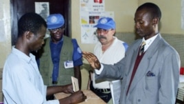 Man votes as UN observers look on in Bangui, Central African Republic