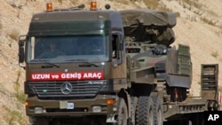 A Turkish military truck transports a mobile missile launcher to the Syrian border, near Kilis, Turkey, June 28, 2012.(AP).