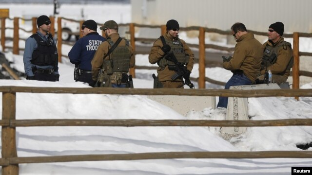 FILE - Members of the Oregon State Troopers and FBI are seen as in Burns, Oregon, Jan. 31, 2016. Four armed occupants remain at the Malheur National Wildlife Refuge near Burns.