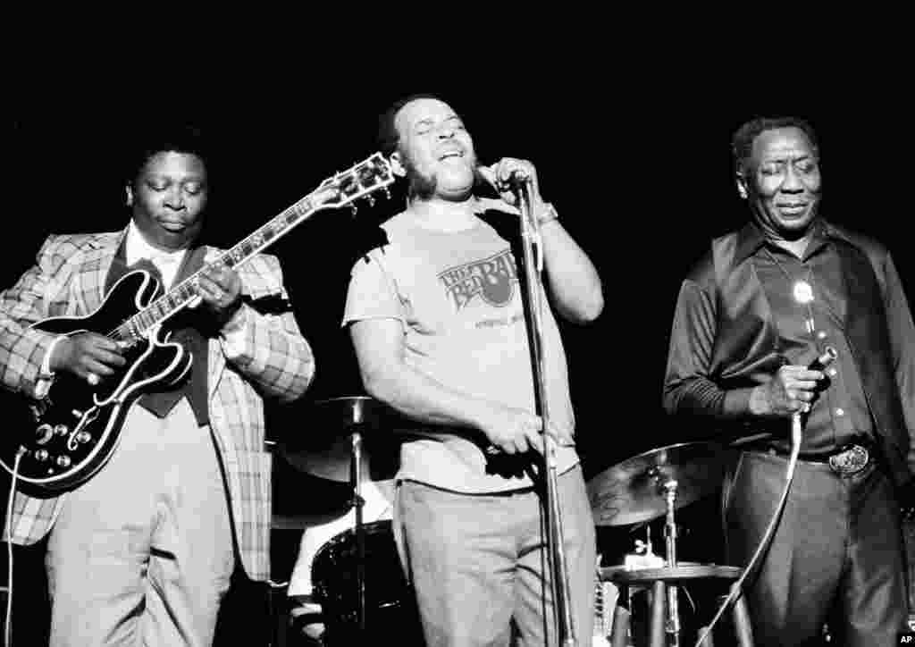 Blues musician B.B. King, left, James Cotton, center, and Muddy Waters perform together at radio city music hall in New York , June 29, 1979.