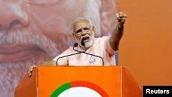 India's Prime Minister Narendra Modi addresses an election campaign rally ahead of the Karnataka state assembly elections in Bengaluru, India, May 8, 2018.