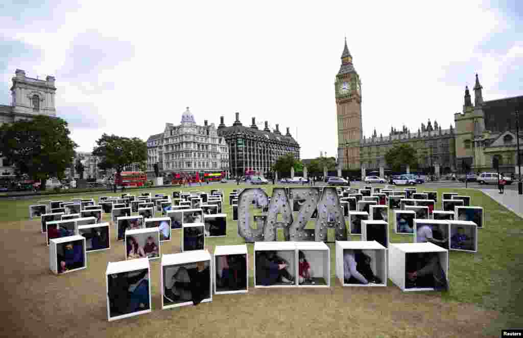 Some 150 men, women and children cram into boxes at Parliament Square in London, in a bid to illustrate the conditions faced by the people of Gaza trapped by the blockade, duing a protest organized by Oxfam.