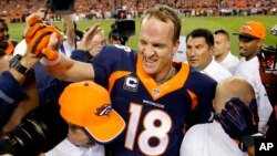 FILE - Peyton Manning celebrates his 509th career touchdown in Denver, Oct. 19, 2014. A Dec. 27, 2015, investigative documentary alleges Manning used performance-enhancing drugs. He denies the claims.