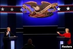 Republican U.S. presidential nominee Donald Trump and Democratic U.S. presidential nominee Hillary Clinton speak at their first presidential debate at Hofstra University in Hempstead, New York, U.S., September 26, 2016.