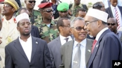 Somali President Sheik Sharif Sheik Ahmed, Puntland President, Abdurrahman Farole, middle, and Somalia Parliament Speaker, Sharif Hassan Sheik Adenduring , right, during the opening ceremony of the high level Consultative Meeting on Ending the Transition