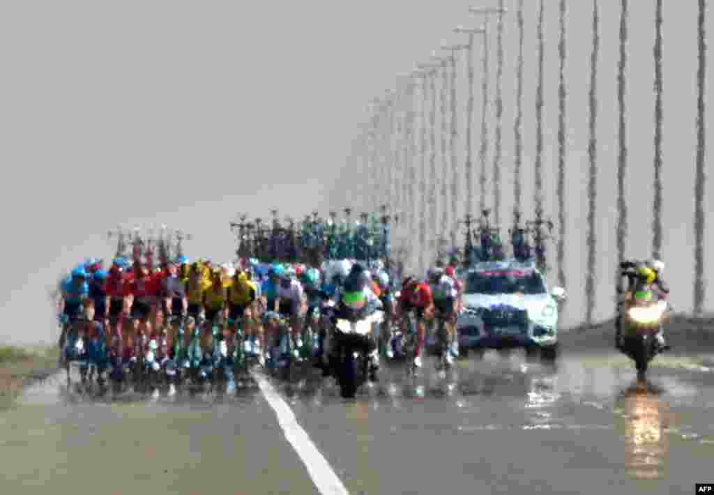 Cyclists compete during the third stage of the UAE cycling tour in al-Ain.