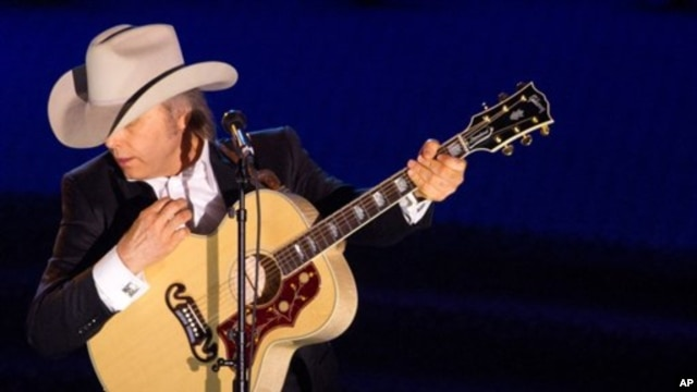 Dwight Yoakam performing at a music awards ceremony in June