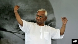India's anti-corruption activist Anna Hazare greets his supporters during the 12th day of his hunger strike in New Delhi, India, August 27, 2011