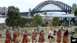 FILE - Traditional Aboriginal dancers perform on Australia Day in Sydney, Australia.