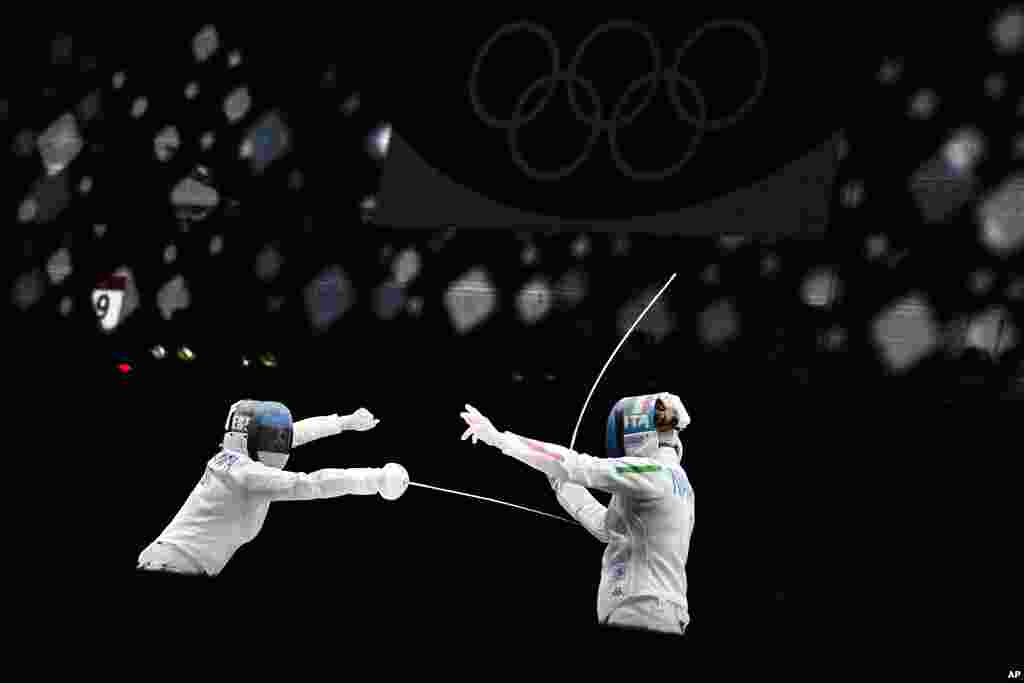 Mara Navarria of Italy, right, and Julia Beljajeva of Estonia compete in the women's individual epee team semifinal competition at the 2020 Summer Olympics, in Chiba, Japan.