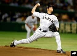 FILE - In this Nov. 19, 2015, file photo, Japan's starter Shohei Otani pitches against South Korea during the first inning of their semifinal game at the Premier12 world baseball tournament at Tokyo Dome in Tokyo.