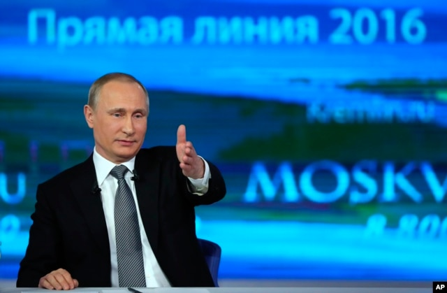 FILE - Russian President Vladimir Putin gestures as he answers a question during his annual call-in show in Moscow, April 14, 2016.