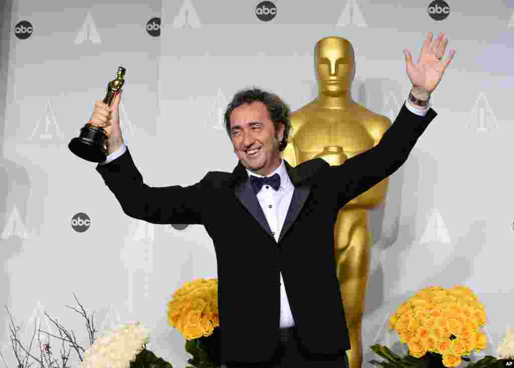 "Paolo Sorrentino poses in the press room with the award for best foreign language film of the year for ""The Great Beauty"" during the Oscars."