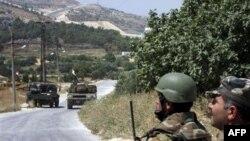Binh sĩ Syria tại làng Istabraq gần thị trấn phía bắc Jisr al-Shughour, ngày 11/6/2011