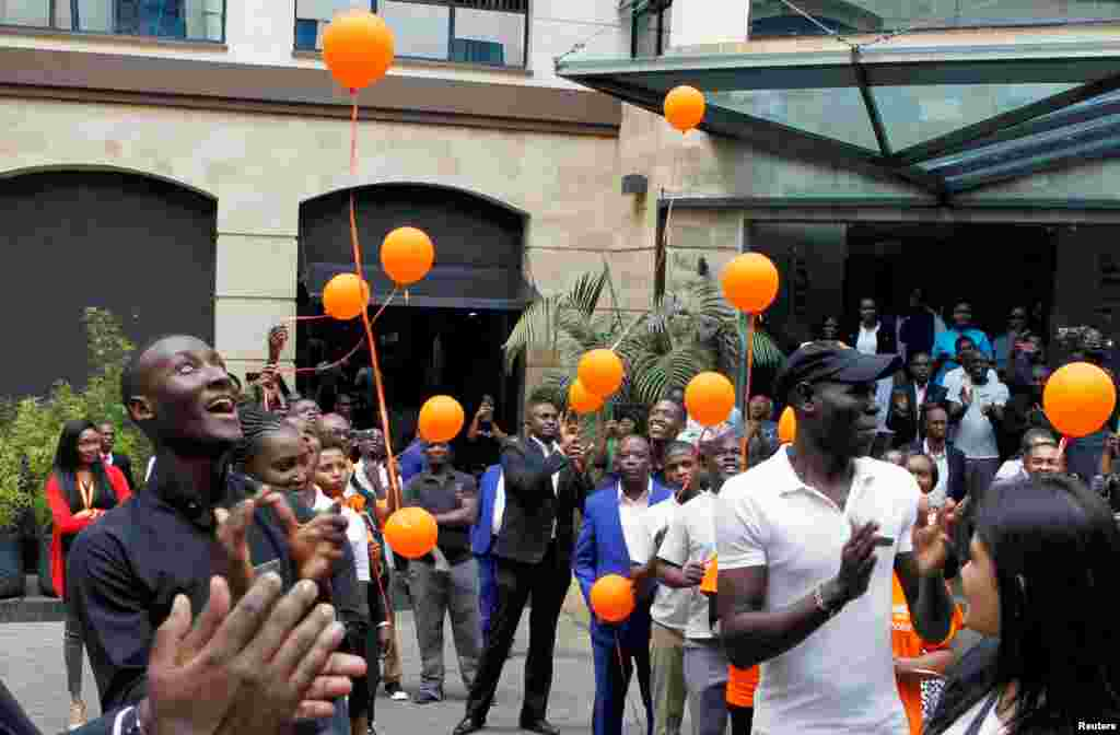 Workers at the DusitD2 Hotel celebrate during its reopening ceremony since its closure following an attack by Al-Shabaab-affiliated militants that killed at least 21 people in Nairobi, Kenya.