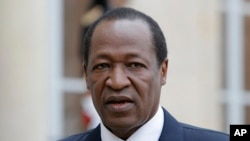 Blaise Compaore, who at the time was Burkina Faso's president, speaks to reporters in Paris, Sept. 18, 2012.